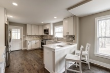 Brand-New Fully-Equipped White-on-White Kitchen w/ Peninsula Island